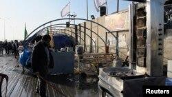 지난 19일 이라크 바그다드 두라 지구에서 발생한 폭탄 공격 현장. 10여명의 시아파 주민이 사망했다.