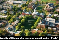 FILE - University of Missouri, Columbia campus, showing Jesse Hall and the Mel Carnahan Quadrangle behind it, and Stankowski Field.