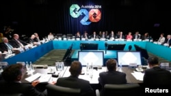 澳大利亞總理阿博特(遠處中央)在布里斯本主持了20國集團峰會的開幕式.