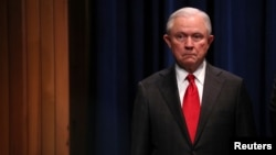 FILE - U.S. Attorney General Jeff Sessions attends a news conference on the arrest of a suspect in the sending of at least a dozen parcel bombs to Democratic politicians and high-profile critics of President Trump.