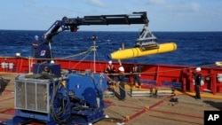 FILE - The United States said last weekend that it would only contribute its sophisticated Bluefin-21 underwater drone for one more month in the search for missing Malaysia Airlines flight MH370.