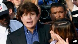 FILE - Former Illinois Gov. Rod Blagojevich, accompanied by his wife Patti, speaks to the media outside his home in Chicago, March 14, 2012.