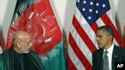 Shugaban Amurka Barack Obama yake ganawa da shugaban Afhanistan Hameed Karzai.