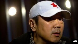 Veteran Chinese rock star Cui Jian pauses while speaking during an interview in Beijing, Dec. 29, 2015. China's Godfather of rock Cui said his message of personal freedom hasn't changed in his new album, even if the world has.