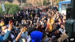 In this Dec. 30, 2017 photo taken by an individual, not employed by the Associated Press and obtained by the AP outside Iran, university students attend a protest inside Tehran University.