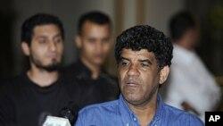 Abdallah Al-Senoussi donne un point de presse à Tripoli, le 21 août 2011