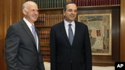 希腊总理帕潘德里欧(左)和希腊反对派领导人安东尼·萨马拉斯(资料照)