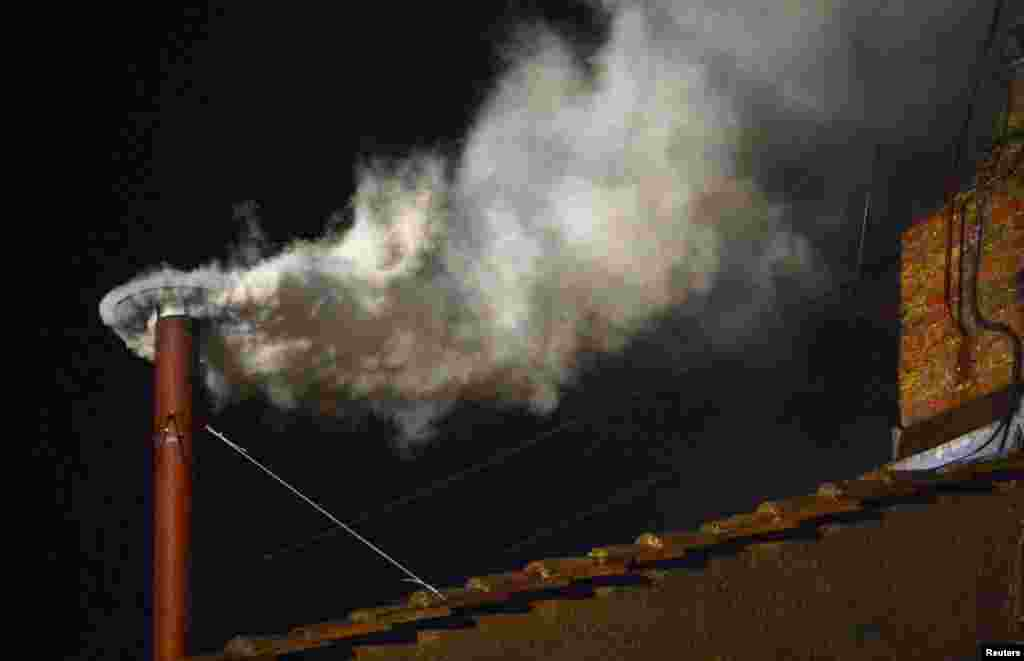 White smoke rising from the chimney on the Sistine Chapel, indicating that a new pope has been elected.