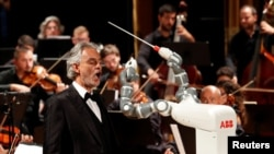 Humanoid robot YuMi conducts the Lucca Philharmonic Orchestra performing a concert alongside Italian tenor Andrea Bocelli at the Verdi Theatre in Pisa, Italy September 12, 2017.