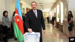 Azerbaijani President Ilham Aliyev casts his vote in Baku, Azerbaijan, Sunday, Nov. 7, 2010.