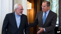 FILE - Iranian Foreign Minister Mohammad Javad Zarif, left, and Russian Foreign Minister Sergey Lavrov enter a hall for their talks in Moscow, Russia, Aug. 29, 2014.