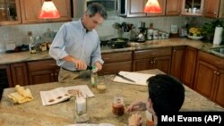 This father in New Jersey fixes dinner for the family, October 2009. It might be a good idea (AP Photo/Mel Evans)