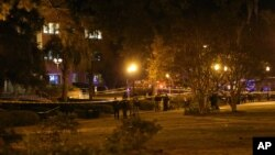 Police investigate a shooting scene at Strozier Library on Florida State campus on Thursday, Nov. 20, 2014.