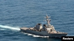 FILE - The guided-missile destroyer USS John S. McCain sails in formation during exercise Foal Eagle 2013 in waters west of the Korean peninsula in this March 21, 2013 handout photo courtesy of the U.S. Navy.