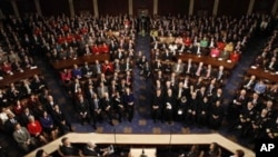 Le président Obama prononçant son discours du l'état de l'Union au Congrès