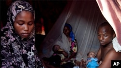 Maryan Jamal Ali gave birth to twins in her tent in Sayidka IDP camp, Mogadishu, Somalia. Photo taken December 13, 2011.