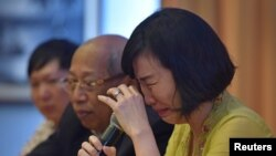"Veronica Tan, the wife of Jakarta's former governor, Basuki Tjahaja Purnama, popularly known as ""Ahok,"" weeps during a news conference in Jakarta, May 23, 2017 in this photo taken by Antara Foto."