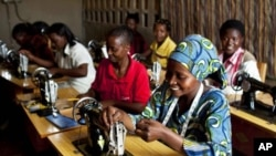 Women who have enrolled in international's programs in Rwanda and the Democratic Republic of the Congo are shown sewing.