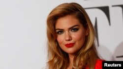 "U.S. actress Kate Upton arrives on the red carpet to promote the movie ""The Other Woman"" in Munich, April 7, 2014."
