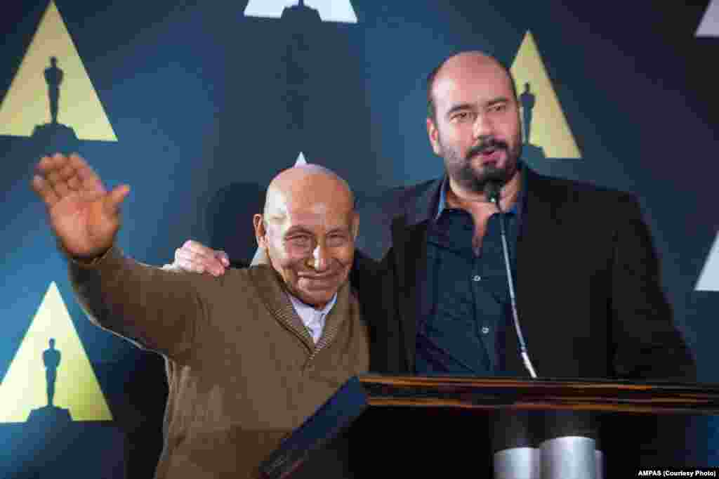 "Antonio Bolivar and Foreign Language Film Award nominee Ciro Guera, ""Embrace of the Serpent"" at the reception for the Foreign Language Film Award category for the 88th Oscars® on Feb. 26, 2016."