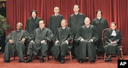 FILE - The justices of the U.S. Supreme Court gather for a group portrait at the Supreme Court in Washington, October 2010.
