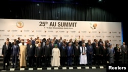 FILE - African leaders pose for pictures ahead of the 25th African Union (AU) summit in Johannesburg, June 14, 2015.