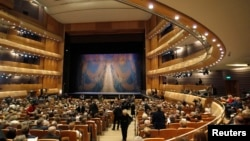 """Guests take their seats for a """"pre-premiere"""" performance, put on for veterans, senior employees of the theater and other special guests, in the new Mariinsky Theater in St. Petersburg, May 1, 2013."""