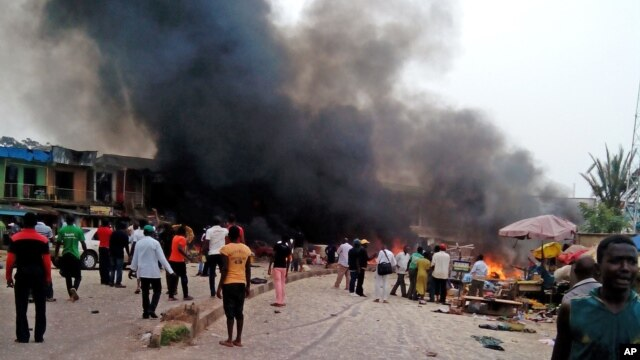 Smoke rises after a bomb blast at a bus terminal in Jos, Nigeria, May 20, 2014.