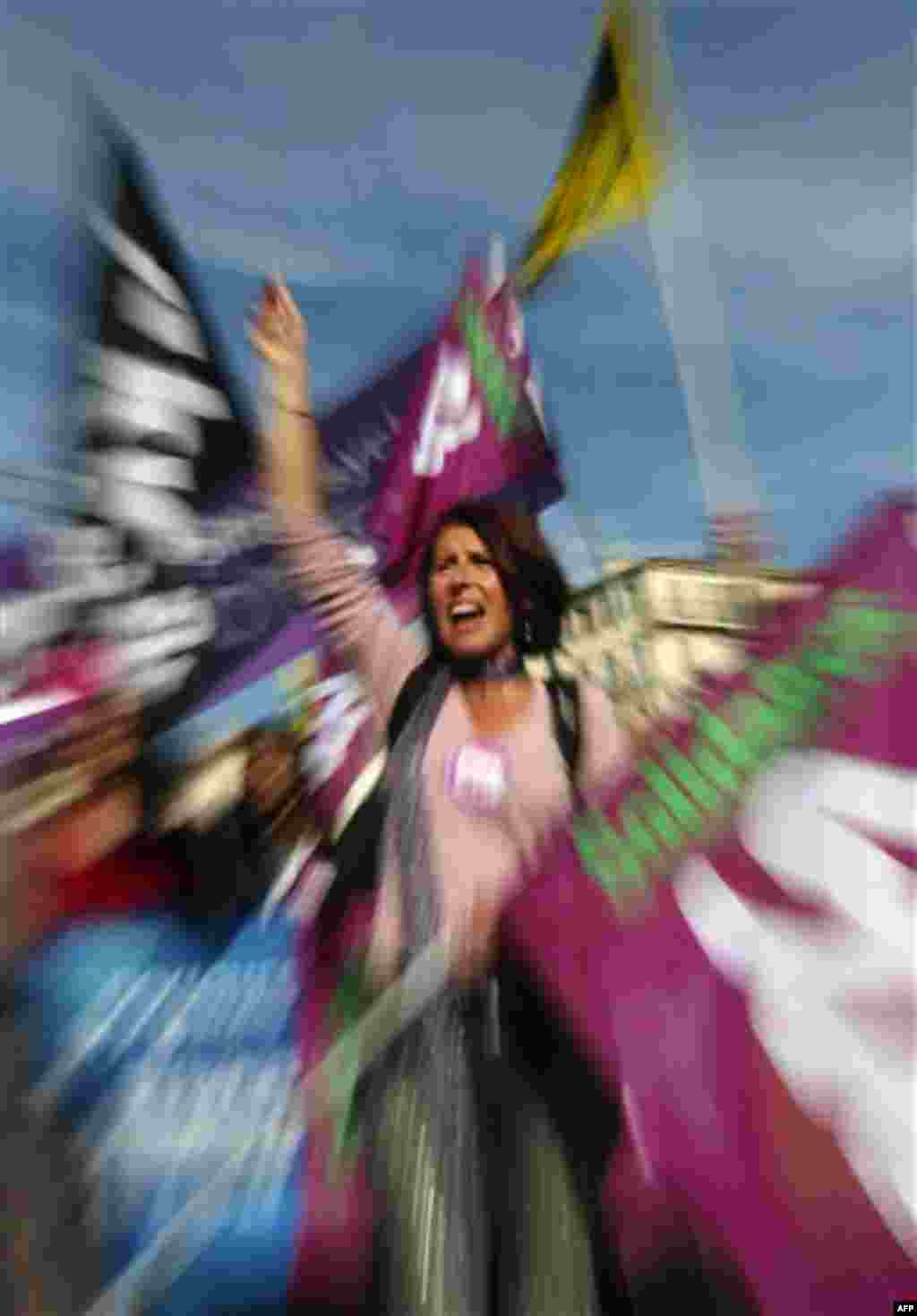 A woman shouts slogans during a demonstration in Marseille, southern France, Thursday, Oct. 28, 2010. Thursday saw more nationwide street protests and strike-caused travel woes even though parliament has already approved President Nicolas Sarkozy's unpopu