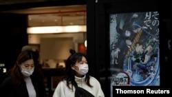 14일 일본 도쿄에서 마스크를 쓴 시민들.