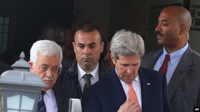 Palestinian President Mahmoud Abbas, left, and U.S. Secretary of State John Kerry walk after their meeting in Amman Jordan, Sunday, Feb. 21, 2016.