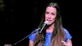 Singer Alanis Morissette addresses the audience at her RockWalk induction ceremony at Guitar Center on Tuesday, Aug. 21, 2012, in Los Angeles.