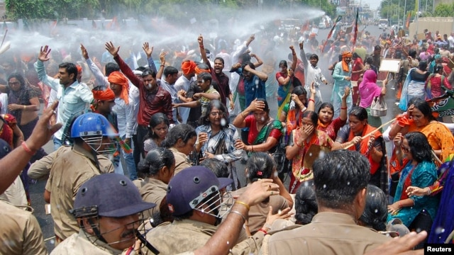 Bharatiya Janata Party supporters are sprayed with a water cannon as police try to stop them from reaching the office of Akhilesh Yadav, chief minister of Uttar Pradesh state, as they protest the recent rape and hanging of two girls, in Lucknow, India, June 2, 2014.