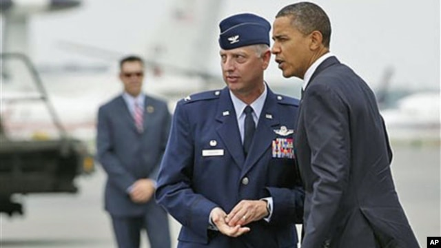 President Barack Obama is greeted by Col. Mark Camerer, the 436th Airlift Wing Commander, upon his arrival at Dover Air Force Base, Dover, Delaware, August 9, 2011