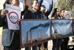 Activists stage a protest against man-made emissions of carbon dioxide and other global warming gases, at the COP22 climate change conference in Marrakech, Nov 16, 2016.