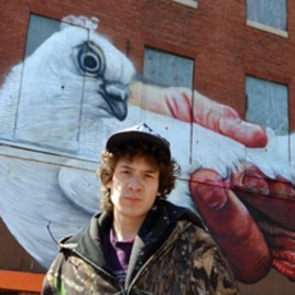 Baltimore street artist, Gaia, curated Open Walls in the city's Station North Arts and Entertainment District. His mural was one of the first to be completed.