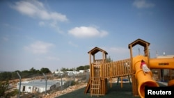 Children climb on a playground in a Jewish settlement in the Etzion settlement bloc, near Bethlehem.