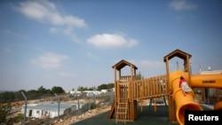 Children climb on a playground in a Jewish settlement in the Etzion settlement bloc, near Bethlehem.