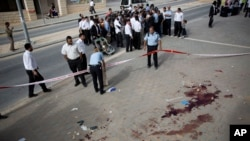 FILE - Israeli police officers inspect the scene of a stabbing attack in Beit Shemesh, central Israel, Oct. 22, 2015. A five-month outburst of violence has killed 27 Israelis and 162 Palestinians.