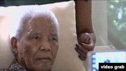 ອະດີດປະທານາທິບໍດີ Nelson Mandela ແຫ່ງອາຟຣິກາໃຕ້
