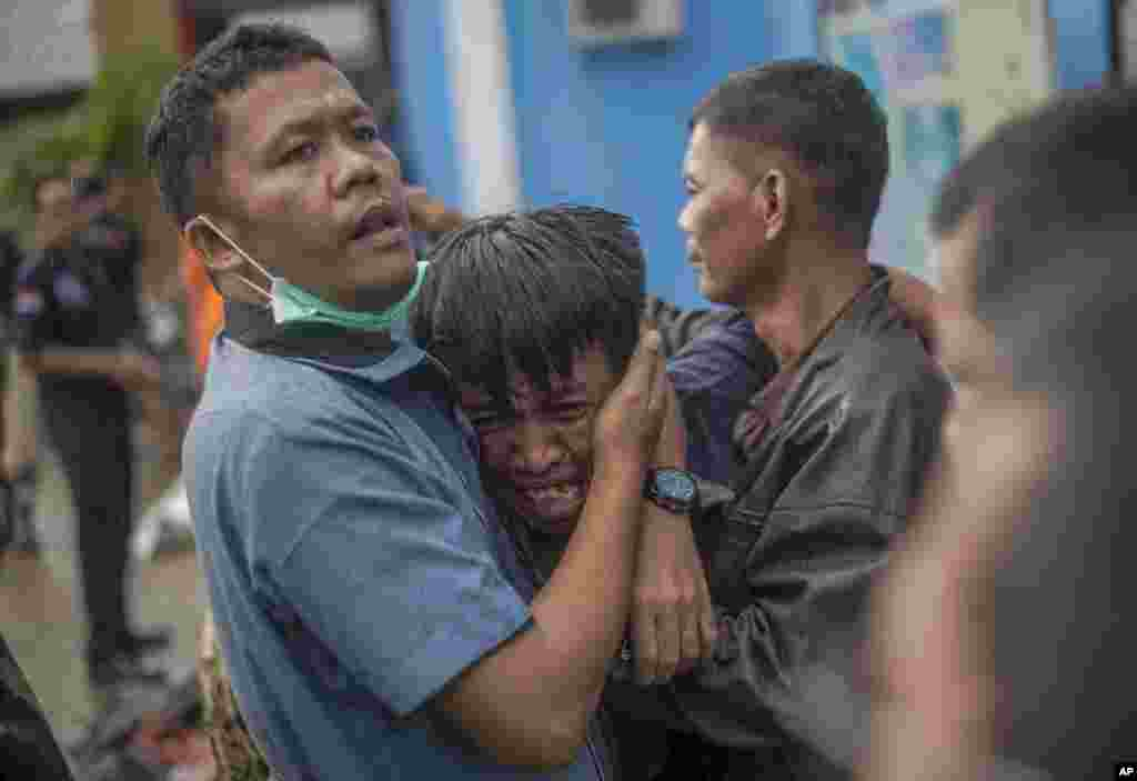 A man reacts after identifying his relative among the bodies of tsunami victims in Carita, Indonesia.
