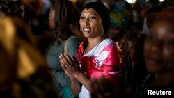 A woman sings during a prayer session at the Saint Francis Xavier parish in Yaounde, Cameroon, in this March 17, 2009 file photo.