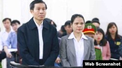 Blogger Nguyen Huu Vinh and his assistant, Nguyen Thi Minh Thuy appear in court.