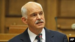 Greek Prime Minister George Papandreou , Oct 31, 2011