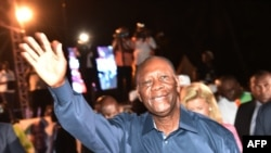 Ivory Coast president Alassane Ouattara waves to supporters after his victory in the presidential election, Oct. 28, 2015, in Abidjan.