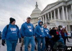 As the impeachment trial of President Donald Trump is conducted inside the Senate, activists attending the March for Life anti-abortion rally visit the Capitol in Washington, Thursday, Jan. 23, 2020.