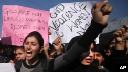 Indian students shout slogans and demand severe punishment for rapists as they condemn the gang-rape of a student in New Delhi during a protest in Jammu, India, December 21, 2012.