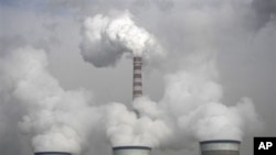 Cooling towers of a coal-fired power plant in Dadong, Shanxi province, China, 03 Dec 2009