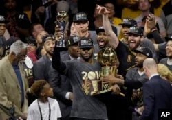 Cleveland's NBA team celebrates its first championship in June.