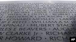 "This sliver of the fallen listed on the Vietnam Veterans Memorial in Washington, D.C., illustrates the panoply of names - from ""Ballegooyen"" to ""Wojcik"" - in the America of today."